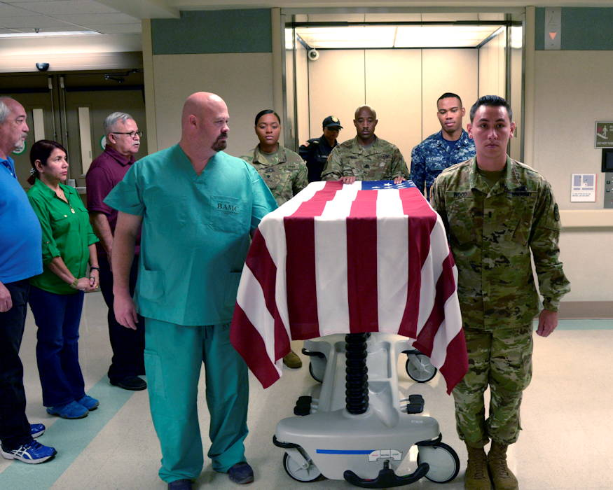 Members of Brooke Army Medical Center's staff practice the rendering of flag honors for fallen heroes on July 3, 2018. No matter the branch, war or length of service, BAMC salutes every veteran and first responder, who dies in the hospital with a flag ceremony by an Honor Guard. (Brooke Army Medical Center photo by Robert Shields, BAMC Public Affairs)