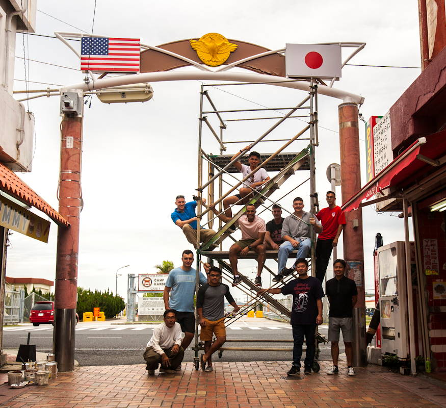 November 17, 2018 - Marines and local residents pose in front of the refurbished archway in Kin Town, Okinawa. Marines with 3rd Intelligence Battalion, III Marine Expeditionary Force from Camp Hansen volunteered to restore the archway outside Camp Hansen Gate 1. (U.S. Marine Corps photo by Nika Nashiro)