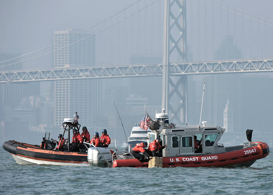 January 17, 2018 - A U.S. Coast Guard boat crew from Maritime Safety and Security Team San Francisco 91105 retrieve a simulated bale of contraband from the water while an Over-The-Horizon Interceptor boat from U.S. Coast Guard Cutter Aspen watches in the San Francisco Bay. The simulated bale was used during a Maritime Object Tracking Technology (MOTT) demonstration that was conducted to test deployment, tracking and retrieval of MOTT in a realistic scenario. (U.S. Coast Guard photo by Petty Officer 3rd Class Sarah Wilson)
