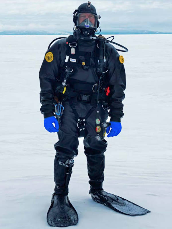 A U.S. Coast Guard cold-water diver prepares to go below the surface to inspect Coast Guard Cutter Polar Star. (U.S. Coast Guard photo by Chief Petty Officer Nick Ameen)