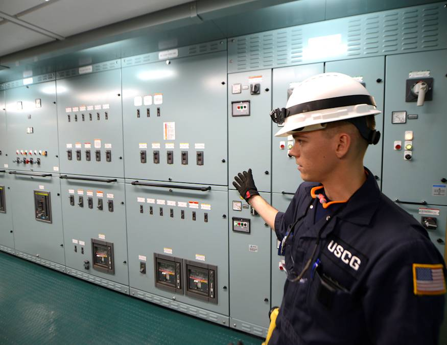 October 4, 2018 - Lt. j.g. Ryan Thomas, a marine Inspector at Coast Guard Sector Delaware Bay, discusses the Coast Guard's role and procedures during electrical testing aboard the Daniel K. Inouye, an 850-foot container ship being constructed in Philadelphia Shipyards. The Daniel K. Inouye is the largest container ship ever built in the United States. (U.S. Coast Guard photograph by Petty Officer 1st Class Seth Johnson)