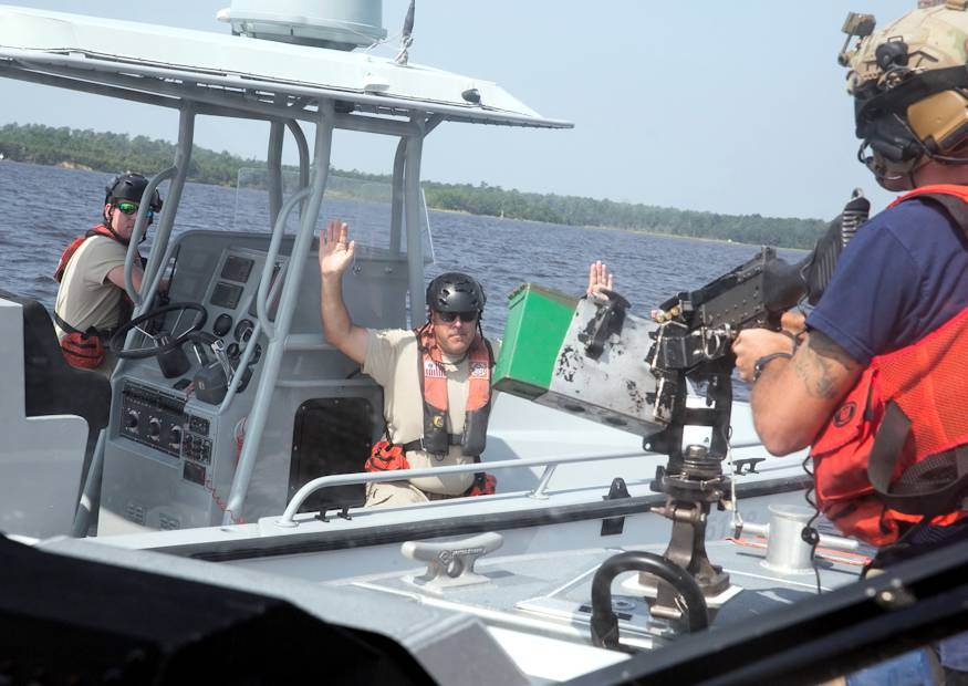 August 23, 2018 - U.S. Coast Guard Petty Officer 2nd Class Nicholas Dziama, a student participating in the Tactical Coxswain Course, subdues a potential vessel posing imminent threat while acting as a bow gunner on Marine Corps Base Camp Lejeune. The course offered the students an opportunity to learn new skills while being exposed to a variety of potential threats including fake improvised explosive devises, rocket-propelled grenade launchers and pistols. (U.S. Marine Corps photo by Lance Cpl. Nicholas Lubchenko)