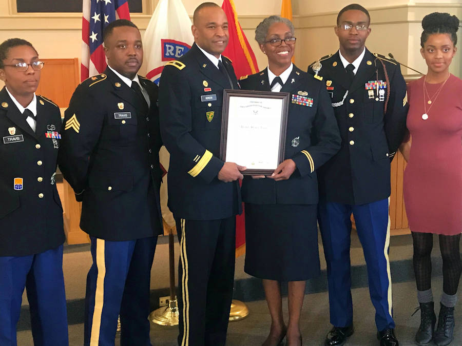 (Center left) Brig. Gen. Kevin Vereen, U.S. Army Recruiting Command Operations deputy commanding general, presents a promotion certificate to Chaplain (Maj.) Sharon Browne, a recruiter with the Southcentral Army Chaplain Recruiting Center, 5th Medical Recruiting Battalion, after making her promotion to major official in a ceremony February 9, 2018 at the Robert P. Taylor Memorial Chapel on Naval Air Station Joint Reserve Base-Fort Worth, Texas. They are joined by Browne's family: (l. to r.) Staff Sgt. Amanda Travis, 32, an information technology specialist with the Information and Educational Technology Division at the U.S. Military Academy, West Point, Pa.; Sgt. James Travis III, 30, a satellite communication systems operator/maintainer stationed at Fort Stewart, Ga.; Sgt. Joshua Travis, 29, a signal support systems specialist and newly assigned instructor at the U.S. Army Signal School, Fort Gordon, Ga.; and Ashley Travis, 26, who recently completed undergraduate studies at the University of Illinois. (U.S. Army photo by 5th Medical Recruiting Battalion)