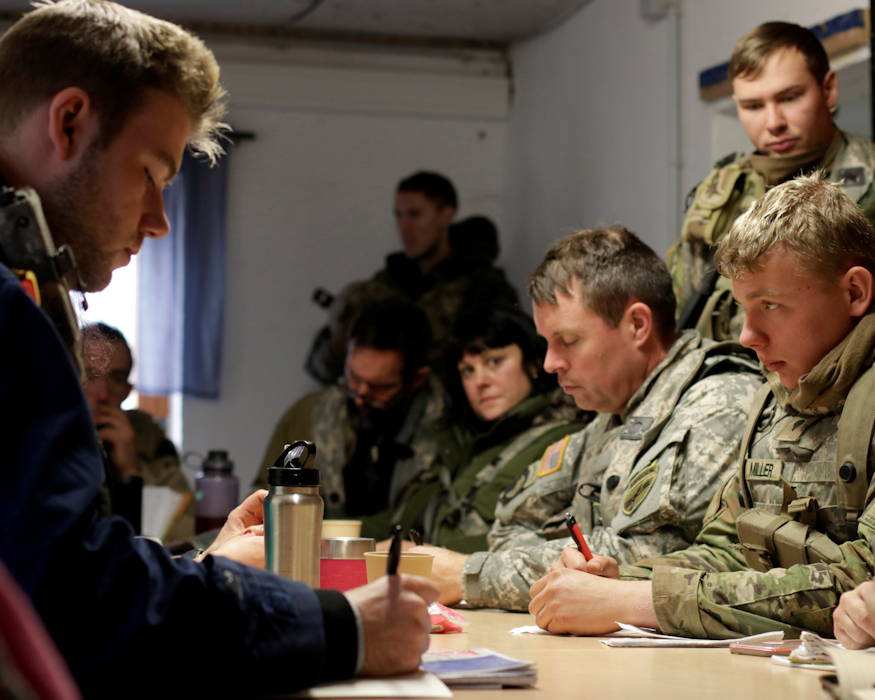 U.S. Army Soldiers with the 407th Civil Affairs Battalion meet with key leaders of Kittensee, a fictional town, during a civilians on the battlefield scenario, in the Hohenfels training area on Dec. 9, 2018 in Hohenfels, Germany. Combined Resolve XI is a biannual exercise that serves as the combat training center certification exercise for regionally allocated forces. This iteration of the exercise takes place in two phases at the Grafenwoehr and Hohenfels training areas between Nov. 26 - Dec. 14, 2018 and Jan. 13 - 25, 2019. (U.S. Army photo by Sgt. Kevin Valentine)