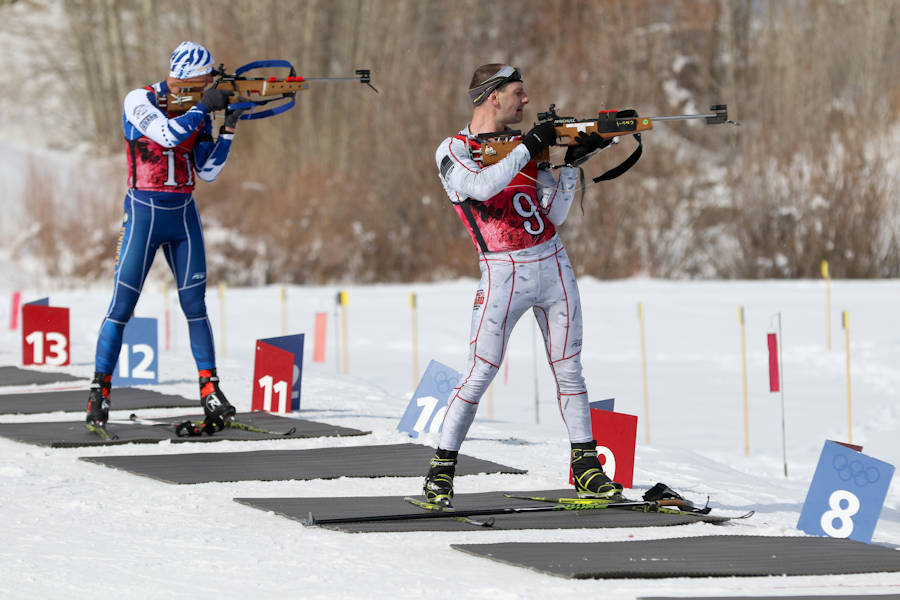 Biathlon competitors representing the Kentucky Guard and California Guard engage grapefruit-sized targets from an offhand firing position during the Chief National Guard Bureau Biathlon Championships in Soldier Hollow, Utah on February 28, 2018. Each competitor must ski between 7.5 and 12 kilometers, while periodically stopping to engage targets ranging from the size of a quarter to the size of a grapefruit, at a distance of 50 meters. (U.S. Army photo by Spc. Nathaniel Free, 128th Mobile Public Affairs Detachment)