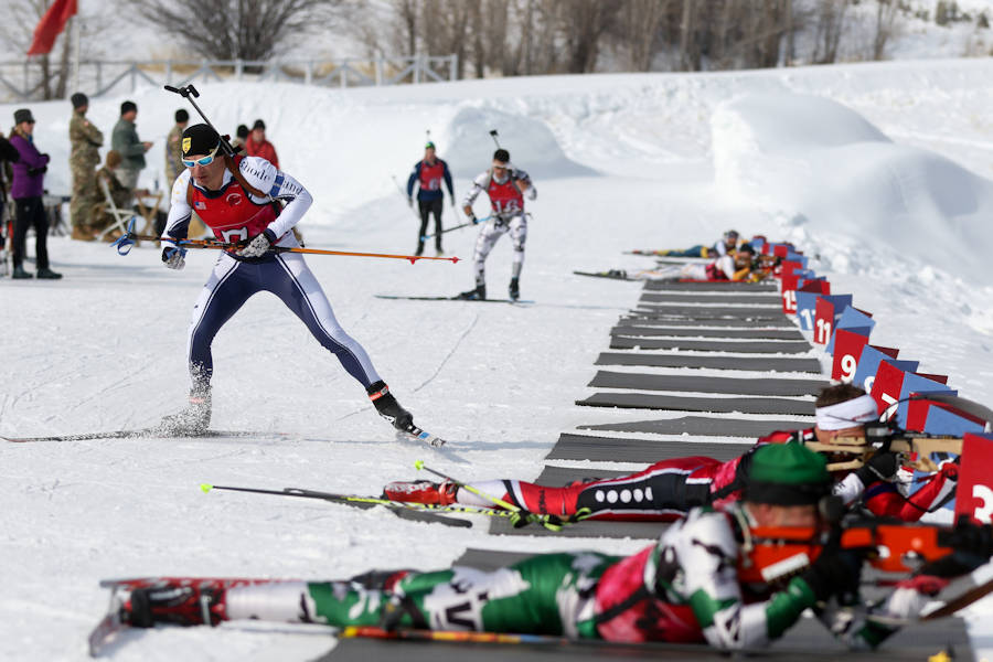 A soldier representing Rhode Island at the 2018 Chief National Guard Bureau Biathlon Championships tears away from the firing range in Soldier Hollow, Utahon February 28, 2018. Each competitor must ski between 7.5 and 12 kilometers, while periodically stopping to engage targets ranging from the size of a quarter to the size of a grapefruit, at a distance of 50 meters. (U.S. Army photo by Spc. Nathaniel Free, 128th Mobile Public Affairs Detachment)