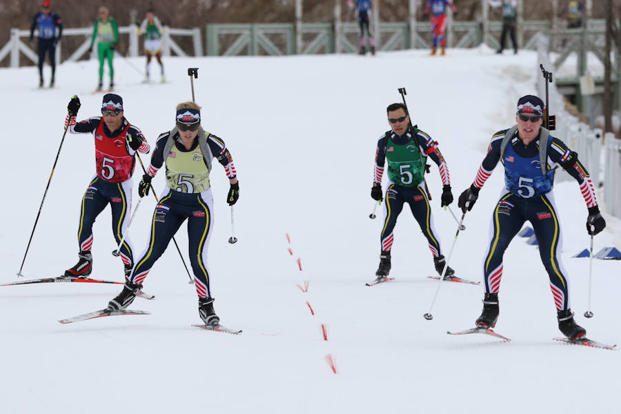 The Colorado Guard team crosses the finish line after completing the men's patrol race, during the Chief National Guard Bureau Biathlon in Soldier Hollow, Utah on March 1, 2018. The patrol race requires competitors to stick together and work as a team to achieve the best time. (U.S. Army photo by Spc. Nathaniel Free, 128th Mobile Public Affairs Detachment)