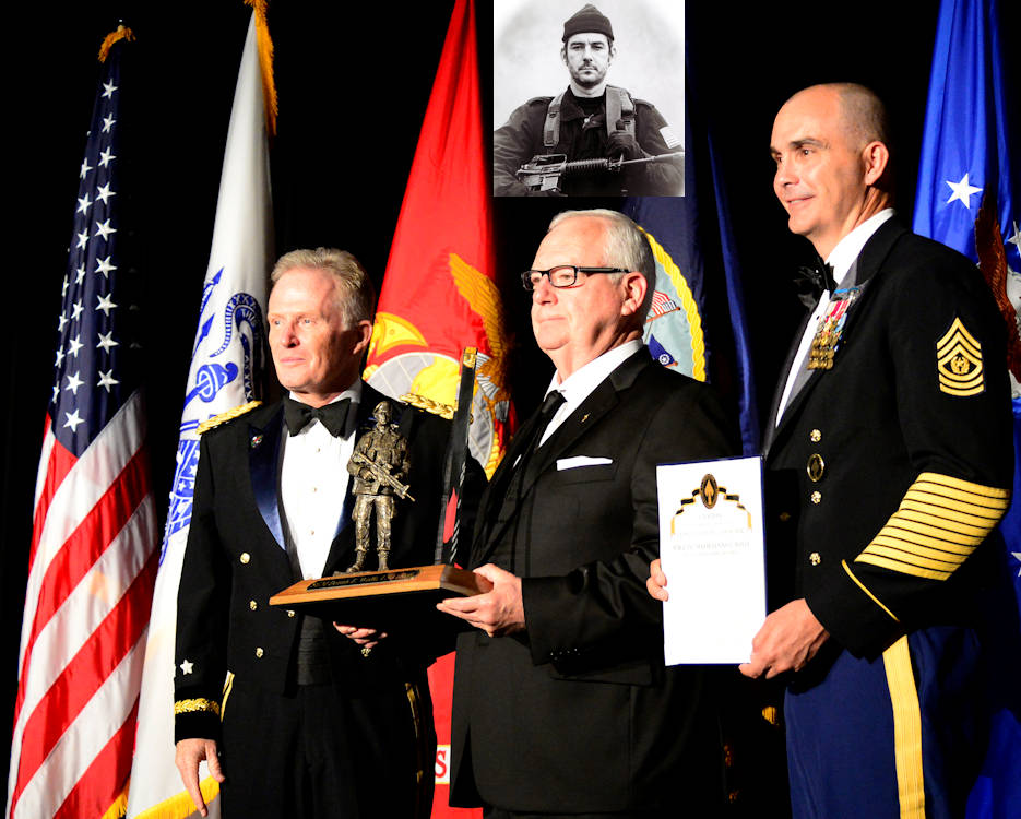 April 18, 2018 - Retired U.S. Army Sgt. Maj. Dennis Wolfe receives U.S. Special Operations Command's 2018 Bull Simons Award from Gen. Raymond A. Thomas, III, commander, USSOCOM in Tampa, Florida. (Image created by USA Patriotism! from inset photo courtesy of retired Sgt. Maj. Dennis Wolfe and award ceremony photo by Michael Bottoms, USSOCOM Office of Communication.)
