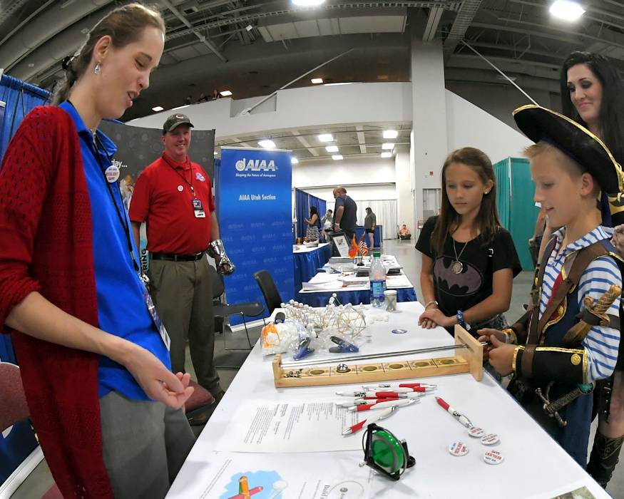 September 7, 2018 - FanX visitors try out toys designed to demonstrate scientific principles and talk with Rachael Beal, 309th Software Maintenance Group, and Rich Houghton, Resilience Chairman for Society of American Military Engineers, both volunteers at the Hill Air Force Base STEM Outreach booth in Salt Lake City. (U.S. Air Force photo by Todd Cromar)