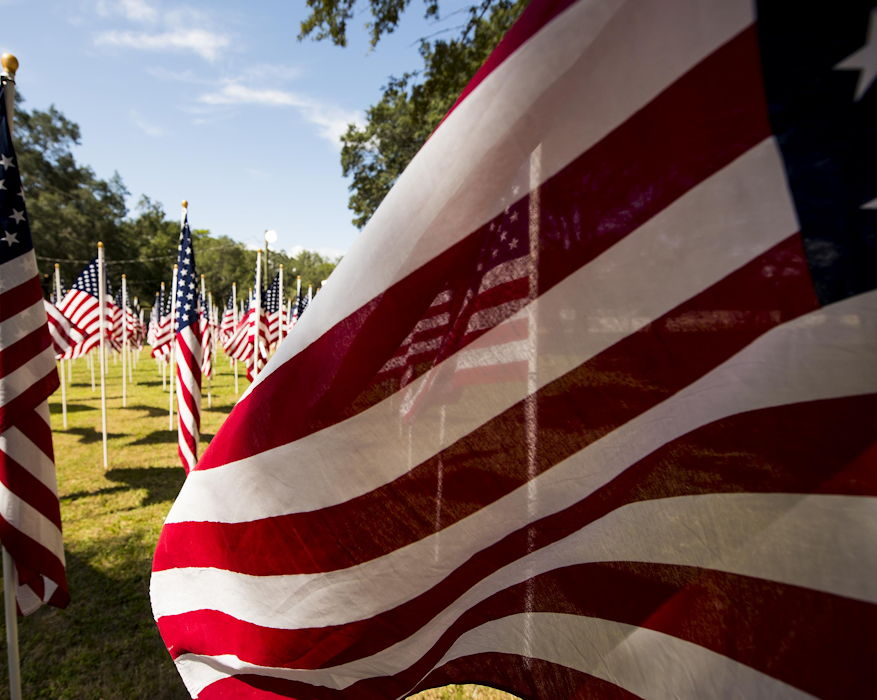 September 14, 2018 - American flags flap in the light breeze on the Field of Valor display in Niceville, Florida. The display features 13 rows of 27 flags and one extra to create the field. Names of recently fallen military members, including 10 Airmen, adorn each of the approximately 352 American flags. (U.S. Air Force photo by Samuel King Jr.)