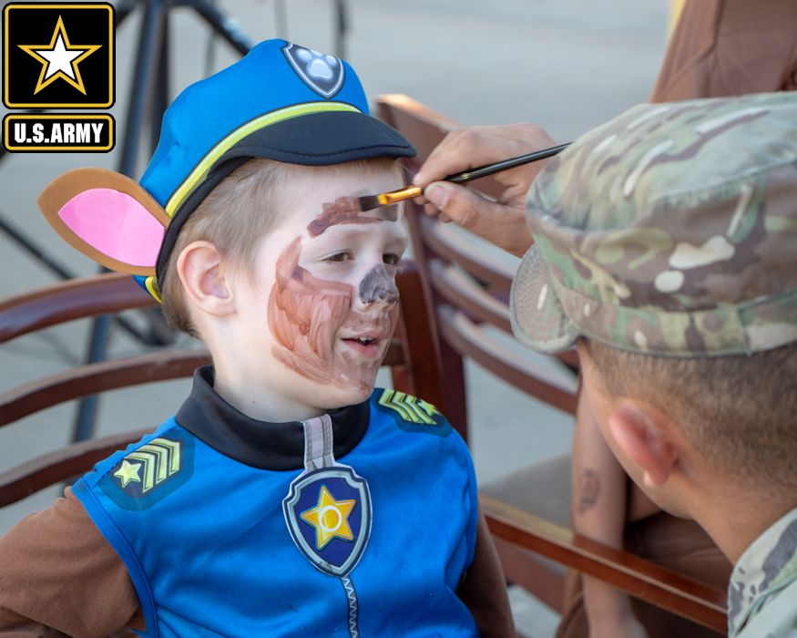 "October 30, 2018 - October 30, 2018 - A military child gets his face painted during 2nd Battalion, 69th Armored Regiment's ""Tank or Treat"" Halloween event in the battalion motor pool at Fort Stewart, Georgia. Soldiers brought their families and children to ""trick-or-treat"" at decorated tanks, ride horses, and paint pumpkins. (Image created by USA Patriotism! from U.S. Army photo by Spc. Jonathan Wallace)"