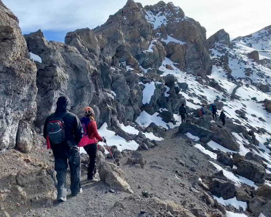 Jeff Crow, material planner in the Defense Logistics Agency Troop Support's Industrial Hardware supply chain, and a fellow climber trek up Mount Kilimanjaro during a trip to Tanzania on December 2018. Crow and his team scaled the 19,340 foot-high mountain. (Photo courtesy of Jeff Crow)
