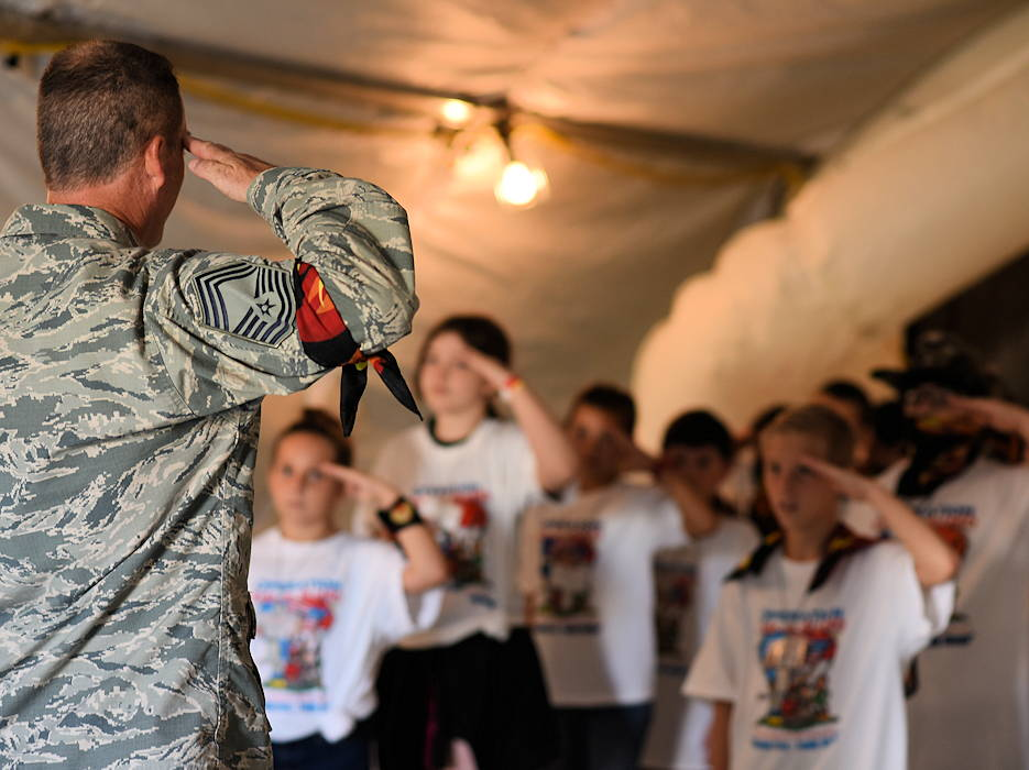 September 8, 2018 - U.S. Air Force Chief Master Sgt. Richard Beard, 145th Aircraft Maintenance Squadron superintendent, teaches military children how to salute during the Annual North Carolina Operation Kids on Guard held at the NC Regional Training Site in Stanly County. Children of military members were able to join in activities including short aircraft rides, engaging with military members while learning flight structure and commands, interactive displays with a C-17 Globemaster III and other aircraft, as well as a ropes course and bouncy castles. (North Carolina Air National Guard by USAF Staff Sgt. Laura Montgomery)