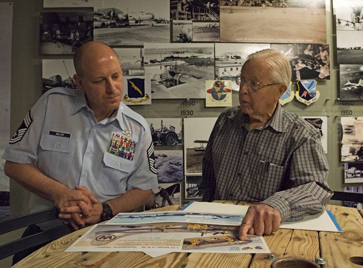 September 29, 2017 - George Prentiss, a Korean War and Air Force veteran, discusses maintenance history with Chief Master Sgt. Christopher Miller, 92nd Maintenance Squadron superintendent, during a base tour at Fairchild Air Force Base. Prentiss joined the Air Force in 1952 as a piston jet maintainer and was stationed at Fairchild for four years. (U.S. Air Force photo by Airman 1st Class Jesenia Landaverde)