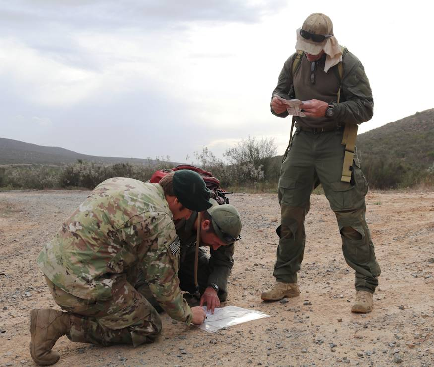 Sgt. First Class Chris*, a member of the California National Guard Counterdrug Task Force, helps law enforcement officers locate their position during land navigation training at Marine Corps Air Station Miramar, February 14, 2018. (U.S. Army National Guard photo by SGT Brianne M. Roudebush)