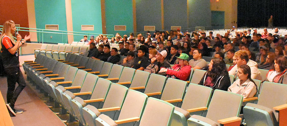 February 21, 2018 - National Hot Rod Association driver Leah Pritchett, talks to students at Skyline High School, Mesa in the school auditorium. Pritchett was representing the U.S. Army Recruiting Command, prior to racing in Chandler, Arizona. (U.S. Army Photo by Alun Thomas, USAREC Public Affairs)