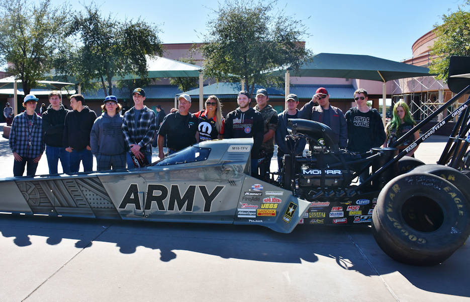 February 21, 2018 - National Hot Rod Association driver Leah Pritchett, poses with students at Skyline High School, Mesa, Arizona by the official U.S. Army dragster. Pritchett was representing the U.S. Army Recruiting Command, prior to racing in Chandler, Arizona. (U.S. Army Photo by Alun Thomas, USAREC Public Affairs)