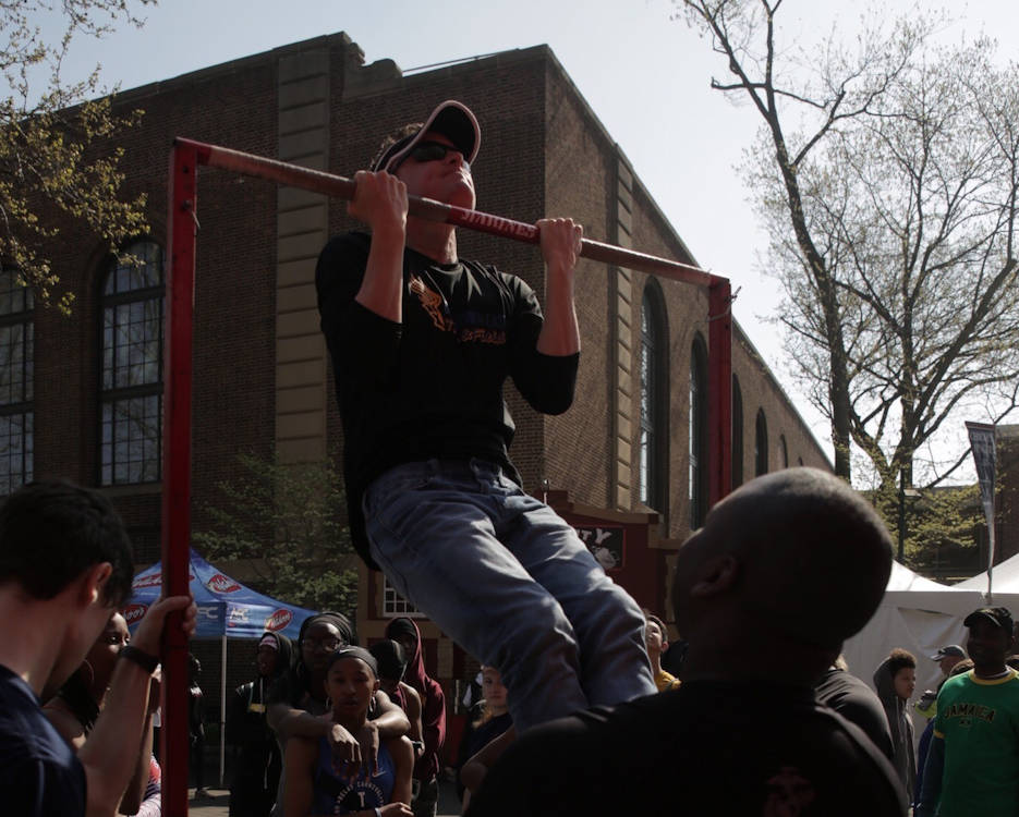 Mike Delone from Chester County, Pennsylvania, participates in a Marine Corps pull-up challenge during the Penn Relays at Franklin Field at the University of Pennsylvania campus, April 28, 2018. Marines partnered with and attended the 124th Penn Relays to foster positive relationships with student athletes and coaches and to educate the track and field community on opportunities within the Marine Corps. (U.S. Marine Corps photo by Lance Cpl. Naomi Marcom)