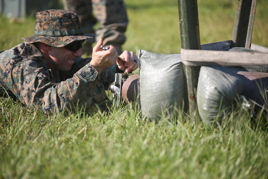 Sgt. Derek Ford fastens a piece of equipment in place during a tool familiarization range aboard MCAS Beaufort on July 11, 2018. (U.S. Marine Corps photo by Lance Cpl. Terry Haynes)