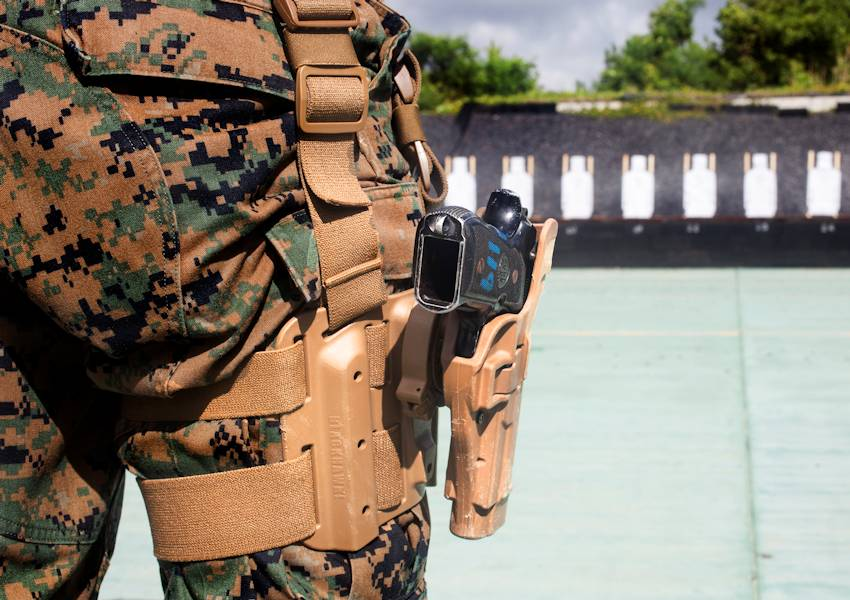A U.S. Marine prepares to draw his Beretta M9 service pistol from its holster during pistol qualification at Camp Hansen, Okinawa, Japan, Sept. 6, 2018. (U.S. Marine Corps photo by Lance Cpl. Tanner Lambert)
