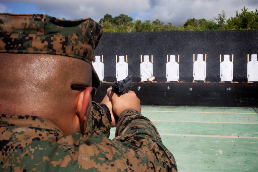 A U.S. Marine with 3rd Law Enforcement Battalion, III Marine Expeditionary Force Intelligence Group fires a Beretta M9 service pistol during pistol qualification at Camp Hansen, Okinawa, Japan, Sept. 6, 2018. Pistol qualification is required annually to sustain the skills of pistol marksmanship. (U.S. Marine Corps photo by Lance Cpl. Tanner Lambert)