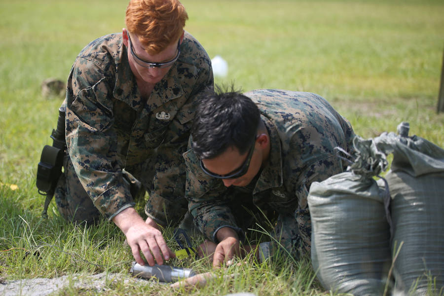 Sgt. Josh Alexander, left, and Staff Sgt. Steve Gomez measure a piece of ordnance during a tool familiarization range aboard MCAS Beaufort on July 11, 2018. (U.S. Marine Corps photo by Lance Cpl. Terry Haynes)