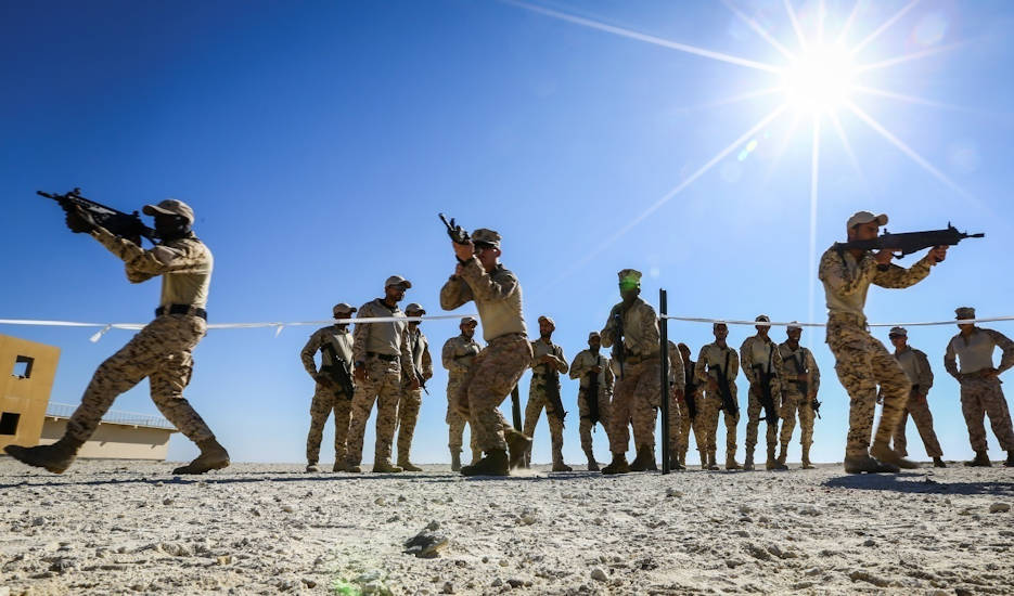 January 14, 2018 -  U.S. Marine Corps riflemen attached to Fleet Anti-terrorism Security Team, Central Command, a subordinate command of Naval Amphibious Force, Task Force 51, 5th Marine Expeditionary Brigade – TF 51/5, demonstrate close quarters battle training to Bahrain Defense Force soldiers. TF 51/5 staff frequently participates in subject matter expert exchange opportunities with partner nations to share expertise in respective fields and build upon partner nation capabilities in order to increase regional stability and improve interoperability. (U.S. Marine Corps photo by Sgt. Wesley Timm)