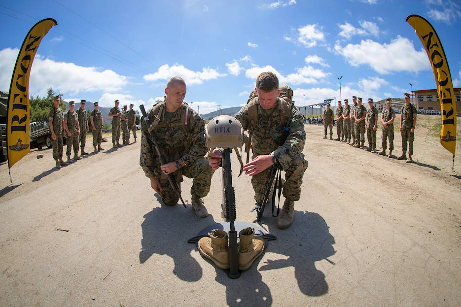 1st Lt. T Markoff, left, assistant operations officer, Marine Wing Support Squadron-372, 3rd Marine Aircraft Wing, and Sgt. Maj. Timothy Riggs, sergeant major MWSS-372, 3rd MAW, kneel in front of a battlefield cross during the 10th Annual Challenge Recon on Marine Corps Base Camp Pendleton, Calif., May 17, 2018. Challenge Recon hosted a total of 16 two-man teams. Each team throughout the event carried a set of dog tags around their neck and an air panel, tied to their packs with the stenciled name of a fallen Marine. (U.S. Marine Corps photo by Cpl. Juan C. Bustos)