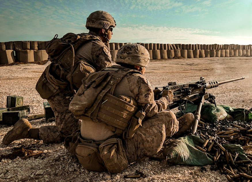 December 22, 2018 - U.S. Marine Corps Lance Cpl. Bryan Riverarojas and Lance Cpl. John Heaney, both rifle Marines with 3rd Battalion, 4th Marine Regiment, 1st Marine Division attached to Special Purpose Marine Air-Ground Task Force Crisis Response-Central Command, fire an Browning M2 .50 Cal. machine gun during training in southwest Asia. The SPMAGTF-CR-CC prioritizes training that enables Marines to respond rapidly to contingencies as necessary across the region. (U.S. Marine Corps photo by 1st Lt. Tori S. Simenec)
