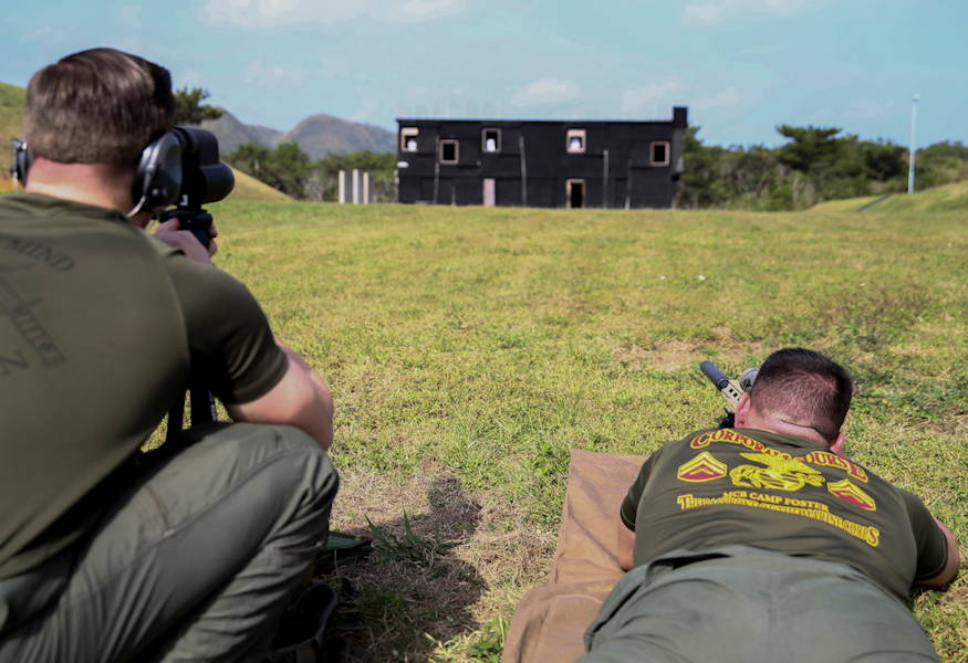 A marksman-observer team with Special Reaction Team, with the Marine Corps Installations Pacific Provost Marshal's Office, prepares to engage targets at Range 171 on Camp Hansen, Okinawa, Japan on November 29, 2018. This exercise allows SRT Marines to practice precision shooting for hostage situations. (U.S. Marine Corps photo by Lance Cpl. Brennan Priest)