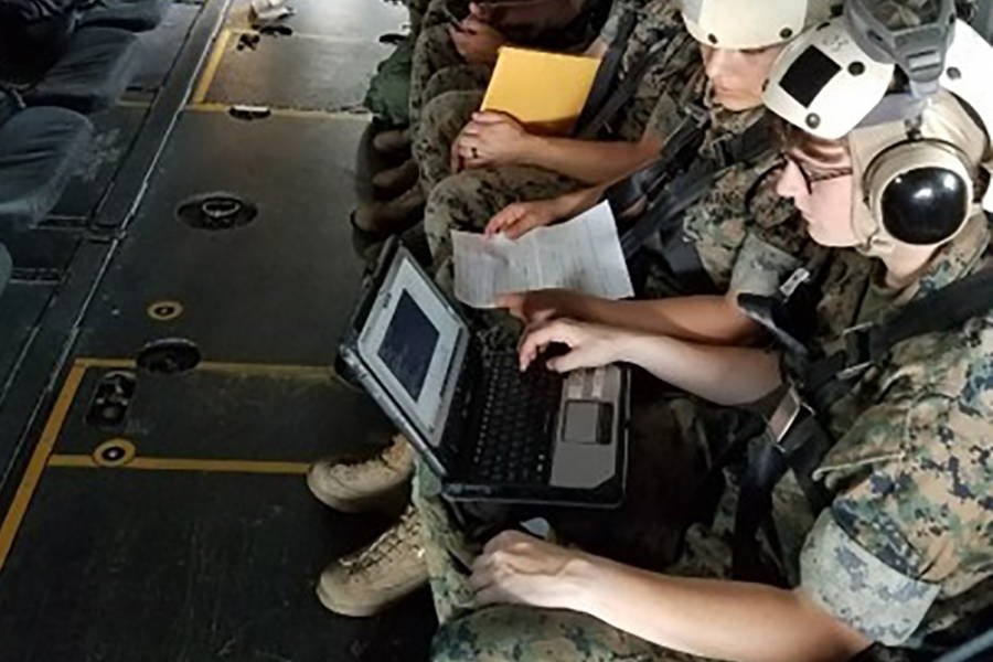 Ground communications specialist Marines use the Networking On-the-Move-Airborne Increment II System on an MV-22 Osprey during a flight at Marine Corps Air Station New River, North Carolina on June 28, 2018. (U.S. Marine Corps photo courtesy of Chris Wagner)