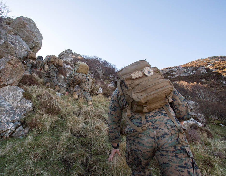 Marines and sailors with 4th Air Naval Gunfire Liaison Company, Force Headquarters Group, scale a mountain to get to their second checkpoint during a land navigation exercise in Durness, Scotland, April 30, 2018. 4th ANGLICO is in Scotland to take part in Joint Warrior 18-1, an exercise that furthers their readiness and effectiveness in combined arms integration, small unit tactics and land navigation. This training aims at improving their capabilities and combat effectiveness and ensures they're ready to fight tonight. (U.S. Marine Corps photo by Cpl. Dallas Johnson)
