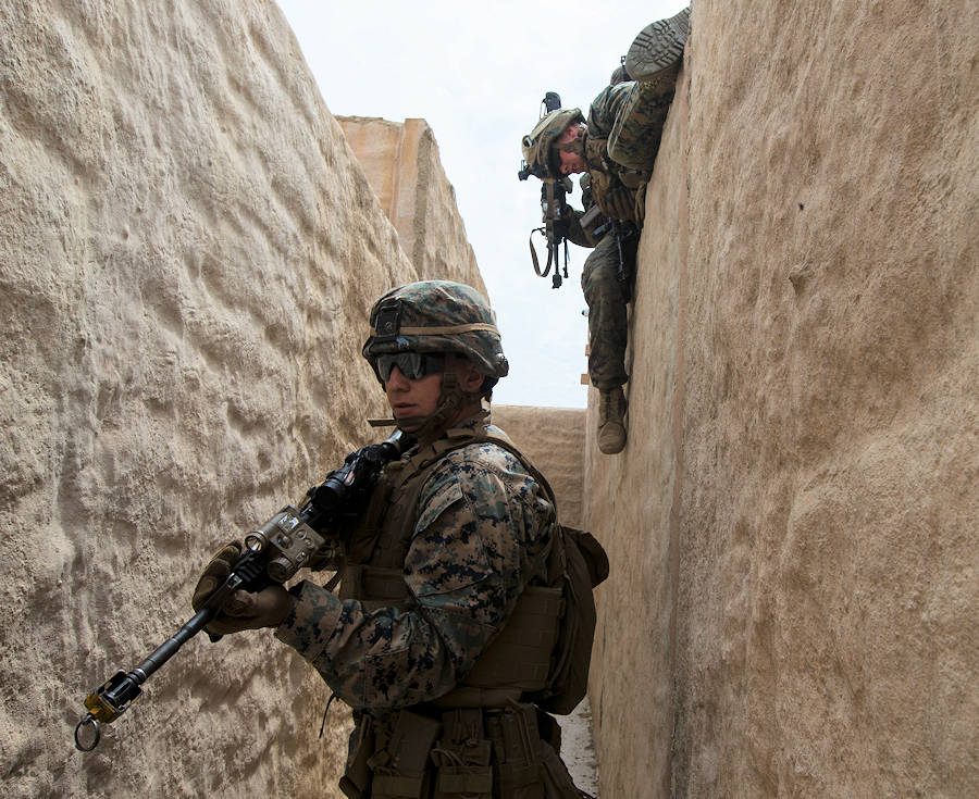 U.S. Marine Corps Lance Cpl. Austin Mellick, a fireteam leader with 2nd Battalion, 1st Marine Regiment, provides security at an Infantry Immersion Trainer during Rim of the Pacific exercise on Marine Corps Base Camp Pendleton, California, July 10, 2018. (U.S. Marine Corps photo by Cpl. Robert Gavaldon)