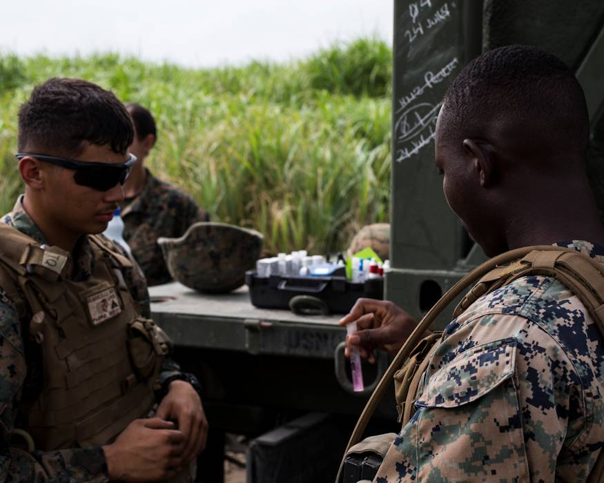 U.S. Marine Corps Lance Cpl. Jesus Delgadillo, left, a water support technician, and Lance Cpl. Daniel Adomina, an electrician, both with Marine Wing Support Squadron (MWSS) 171, test water for contaminants during Exercise Eagle Wrath 18 at Combined Arms Training Center Camp Fuji, Japan on July 23, 2018. Eagle Wrath 18 is an annual training exercise designed to increase squadron proficiency in a forward operating environment, test forward command and control structure, and practice for real-world contingency missions. (U.S. Marine Corps photo by Lance Cpl. Seth Rosenberg)