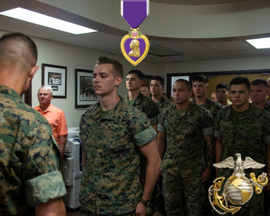 Lance Cpl. Dillon Bennett, machine gunner, 3rd Battalion, 7th Marine Regiment, receives a Purple Heart from Col. Kyle B. Ellison, commanding officer, 7th Marine Regiment, at 7th Marines' Headquarters aboard the Marine Corps Air Ground Combat Center, Twentynine Palms, Calif., July 27, 2018. Bennett received the Purple Heart for wounds sustained while deployed in support of Operation Inherent Resolve on July 9, 2018. (Image created by USA Patriotism! from U.S. Marine Corps photo by Lance Cpl. Dave Flores)