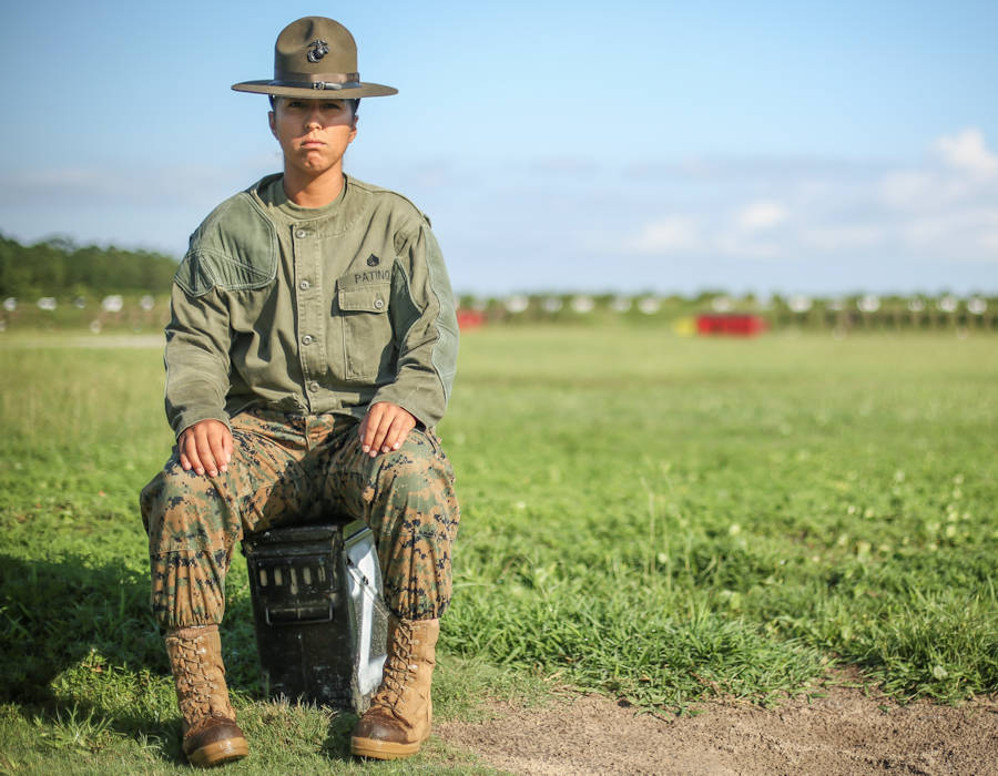 U.S. Marine Corps Staff Sgt. Estefania Patino, a Primary Marksmanship Instructor at Marine Corps Recruit Depot Parris Island, S.C., poses for a photo at Hue City Range on July 24, 2018. (U.S. Marine Corps photo by Sgt. Dana Beesley)