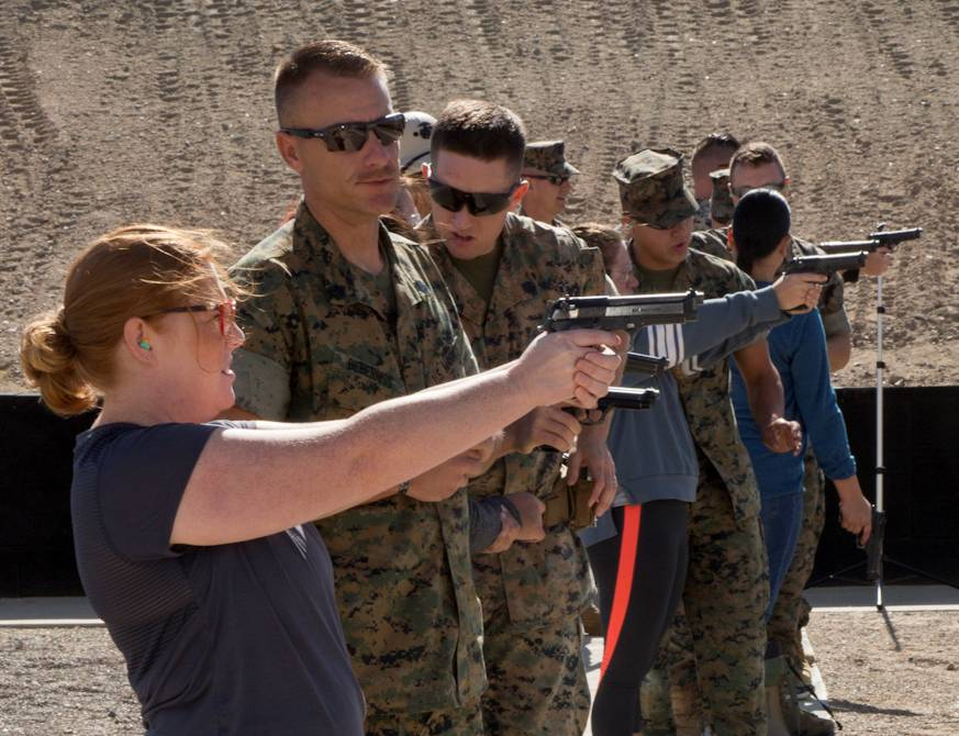 October 12, 2018 - Miliatry spouses and civilians familiarize themselves with semi-automatic pistols during the weapons-firing portion of Jane Wayne Day activities held aboard Marine Corps Logistics Base Barstow, California. Active duty Marines assist the ladies in experiencing a day in the life of military personnel. (Image created by USA Patriotism! from U.S. Marine Corps photos by Keith Hayes)