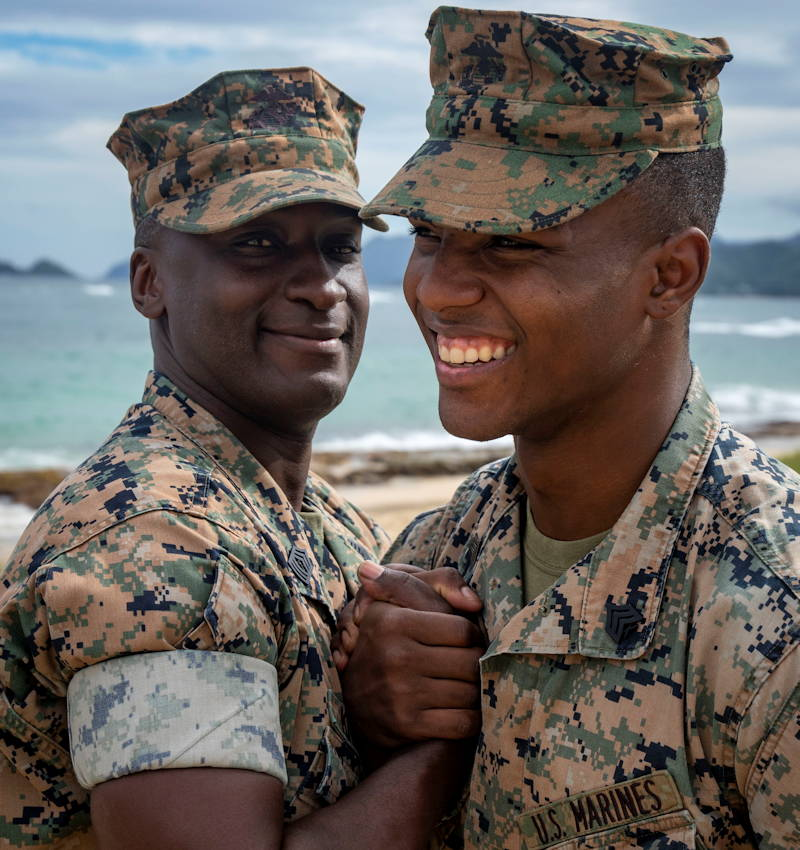 Master Sgt. Ezekiel Kitandwe, the staff noncommissioned officer in charge of Marine Corps Base Hawaii (MCBH) Communication Strategy and Operations, congratulates Sgt. Zachary Orr following his re-enlistment ceremony, MCBH, November 15, 2018. (U.S. Marine Corps photo by Cpl. Luke Kuennen)