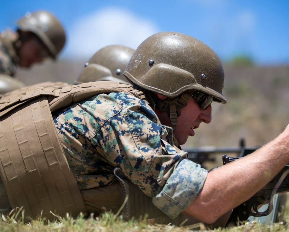 Staff Sgt. Martin Schmitt, training chief, 4th Reconnaissance Battalion, clears an M240B machine gun during the marksmanship portion of the 10th Annual Recon Challenge on Marine Corps Base Camp Pendleton, Calif., May 17, 2018. Marines are expected to be proficient with various weapon systems and are constantly challenged to demonstrate their skills in contests, such as the Recon Challenge. (U.S. Marine Corps photo by Cpl. Juan C. Bustos)