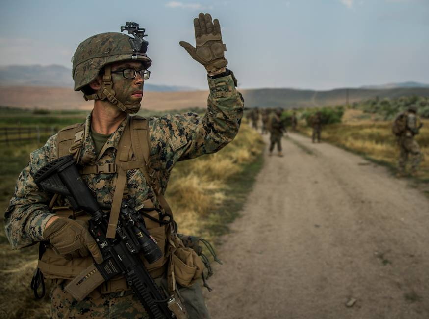 Lance Cpl. Jacob Weatherford, a rifleman with India Company, 3rd Battalion, 5th Marine Regiment, 1st Marine Division, signals for a halt on a hike during Mountain Training Exercise 4-18 aboard Mountain Warfare Training Center Bridgeport, California on July 30, 2018. 3rd Bn., 5th Marines, conducted a Marine Corps Combat Readiness Exercise while in Bridgeport to certify that battalion is ready to become a part of the 11th Marine Expeditionary Unit as their ground combat element. (U.S. Marine Corps photo by Cpl. Adam Dublinske)