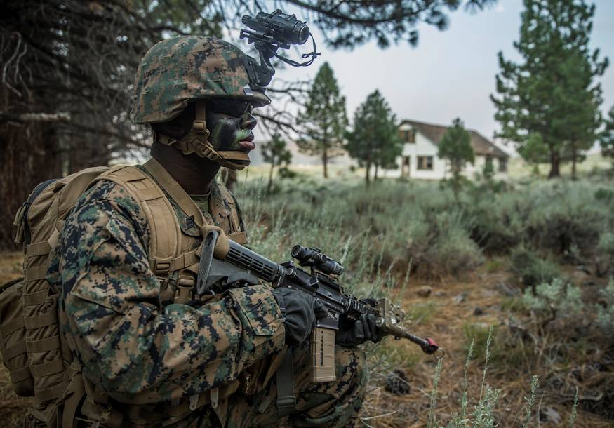 U.S. Navy Seaman Roy Wells, a hospital corpsman with India Company, 3rd Battalion, 5th Marine Regiment, 1st Marine Division, holds position during a hike during Mountain Training Exercise 4-18 aboard Mountain Warfare Training Center (MWTC) Bridgeport, California on July 30, 2018. MWTC Bridgeport provides units a unique training experience by allowing the Marines to train in a mountainous environment and at high altitudes. (U.S. Marine Corps photo by Cpl. Adam Dublinske)