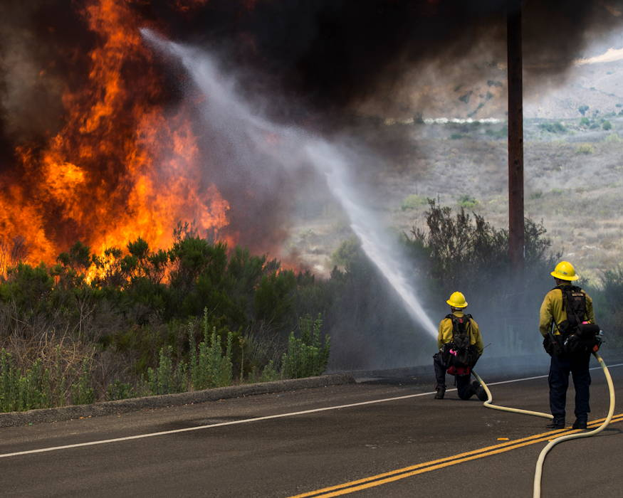 Firefighters with the Camp Pendleton Fire Department combat The Pendleton Complex Fire in the Santa Margarita/De Luz Housing area on Marine Corps Base Camp Pendleton, California on July 6, 2018. (U.S. Marine Corps photo by Cpl. Dylan Chagnon)