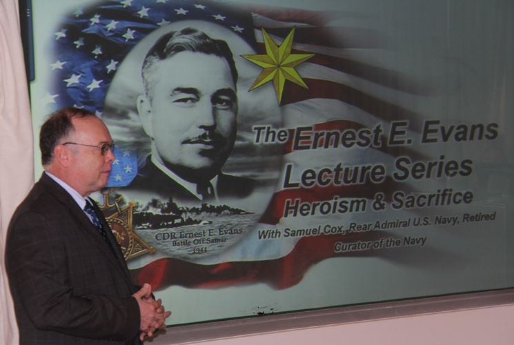 November 15, 2017 - Rear Adm. (Ret.) Samuel Cox, Director of the Naval History and Heritage Command, recently talked about his hero, Medal of Honor recipient Cmdr. Ernest Evans, at Combat Direction Systems Activity Dam Neck. The presentation was in honor of National American Indian Heritage Month. Evans was half-Cherokee and one-quarter Creek Indian and commanded USS Johnston (DD 557) in the Battle off Samar in World War II. (U.S. Navy photo by Joe Navratil, NSWC)