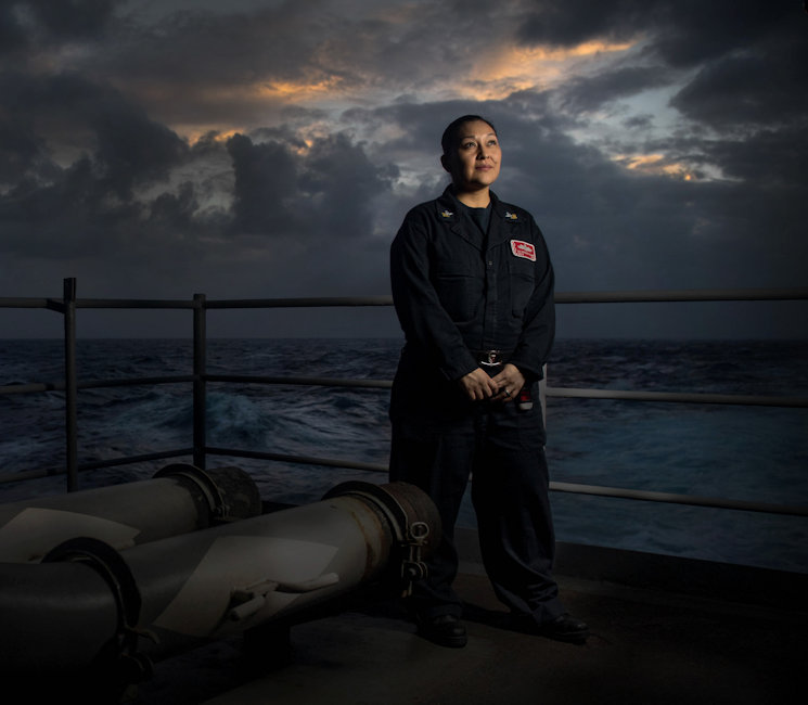 November 22, 2017 - Operations Specialist 1st Class Denise Alamo, a Navajo native American, on the fantail of the aircraft carrier USS Nimitz (CVN 68) at sunset. Nimitz and its strike group are on a regularly scheduled deployment in the 7th Fleet area of responsibility in support of maritime security operations and theater security cooperation efforts. The U.S. Pacific Fleet has patrolled the Indo-Pacific routinely for more than 70 years promoting regional security, stability, and prosperity. (U.S. Navy photo by Mass Communication Specialist 1st Class Marcus L. Stanley)