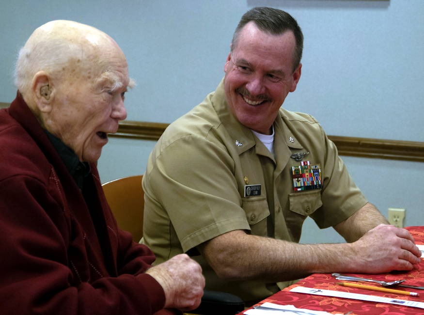 December 7, 2018 - Cmdr. Rocky Pulley, commanding officer, Naval Magazine Indian Island, speaks with Roy Carter, a Navy veteran and survivor of Pearl Harbor, during a luncheon with veterans at the Sherwood Assisted Living facility. Sailors from Naval Magazine Indian Island and Naval Base Kitsap-Bangor traveled to Sequim to have lunch with veterans living in Sherwood Assisted Living in remembrance of Pearl Harbor. (U.S. Navy photo by Mass Communication Specialist 2nd Class Wyatt Anthony)