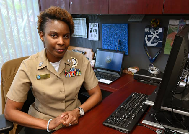 Personnel Specialist 1st Class Tonya Robert at Navy Recruiting District (NRD) Miami on May 18, 2018. (U.S. Navy photo by Chief Mass Communication Specialist Kathleen Gorby)