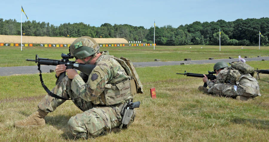 1st Lt. Garrett Miller, All Guard International Combat Team member from Pennsylvania Army National Guard, engages his final targets 100 meters away after having just ran five 100 meter sprints, while engaging targets every 100-200 meters along the way. This was one of several events in the 2018 UK Defence Operational Shooting Competition that was held jointly at Bisley Camp and the Army Reserve Training Centre Pirbright, England held June 17-26, 2018. (National Guard photo by U.S. Army Maj. Theresa Austin)