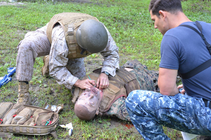 Marine Corps Installations-East Sgt. Major Charles Metzger performs a tracheotomy on a mannequin during a recent Tactical Combat Casualty Care course at Naval Medical Center Camp Lejeune during June 2018. (U.S. Navy photo by Naval Medical Center Camp Lejeune Public Affairs)