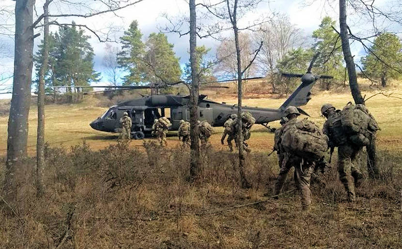 Paratroopers from 1st Battalion (Airborne), 503rd Infantry Regiment (1/503), 173rd Airborne Brigade air assault into a live-fire training exercise in Grafenwoehr, Germany, in April 2018. In February 2018, Soldiers with the 173rd were among the first in the Army to receive new electronic warfare prototype systems that enable the U.S. Army to contest and challenge near-peer adversaries in this critical domain. (U.S. Army photo by 1st Battalion, 503rd Infantry Regiment Public Affairs)