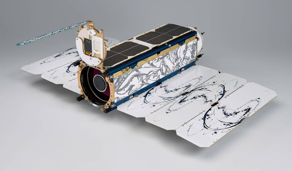 "Among other benefits, the smaller size of Planet's Dove satellites—about as big as a loaf of bread—brings the satellite down ""off the pedestal,"" in Schingler's words, letting engineers see the whole system instead of just the subsystem they work on and think more critically about what it can do. (Photo courtesy of Planet - 2018)"